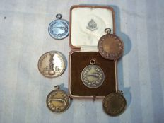 6 shooting medals of which 1 in box, of the NAAFI