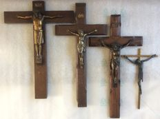 Old crucifixes with Jesus figure (copper/bronze) on solid wood and metal
