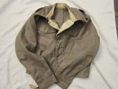 A beautiful used standard equipment '40 Pattern 1945 dated British BD (Battle Dress) uniform coat