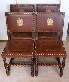 Four Spanish chairs oak wood with twisted legs and leather seats with beautiful copper furniture nails 1920s