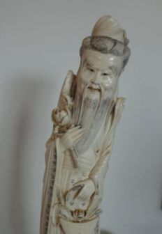 Large ivory statue of God holding a lotus flower and a basket of orchids - China - ca. 1930-1940