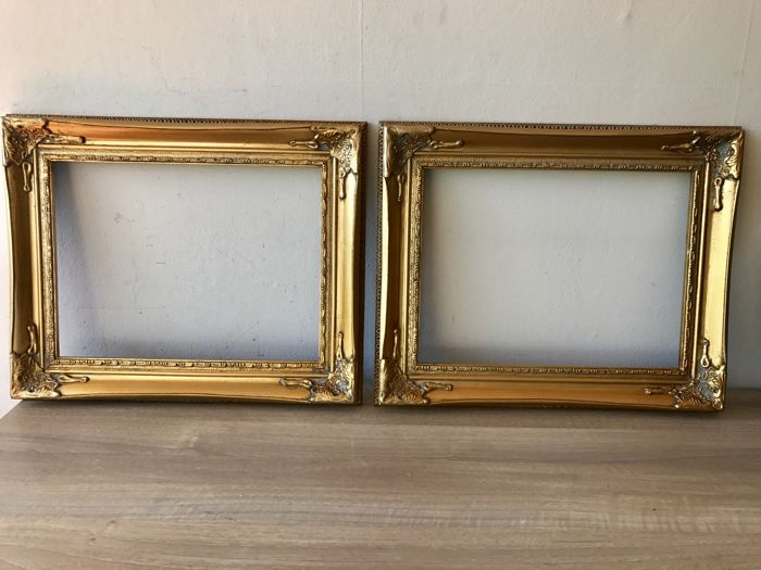 Two large gold plated picture frames in Baroque style - inside ...