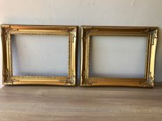Two large gold plated picture frames in Baroque style - inside dimension are 40.5 x 30.5 cm - slot is 0.8 cm