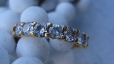 Yellow gold channel ring with 9 brilliant cut diamonds