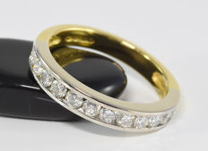 0.98 ct diamond half eternity ring in 18 kt gold