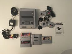 Super nintendo Snes Console- complete with 2 games , 1 scope cassette and super gameboy with original manual