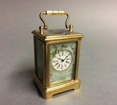 Small brass carriage clock with blue porcelain and depiction of storks -- Period late 20th century