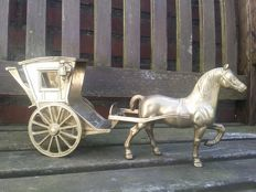 Old copper horse with carriage