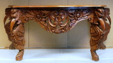 Hand-carved oak side table with floral and bird's head images, 1st half of the 20th century