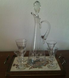 Antique cut decanter with four antique cut wine glasses on tray with decoration of branch with blackberries
