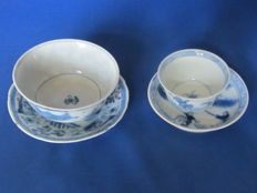 2 cups and saucers with hunting scenes and lanscapes in panels - China - around 1800