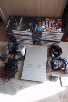 PS2 incl 2 controllers , 20 games and all cables
