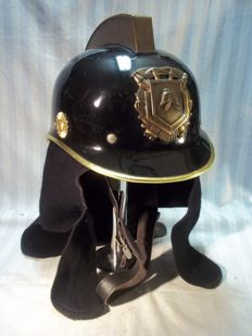 Dutch fire helmet with logo and neck flap. 70s.