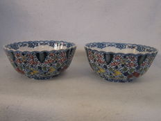 Makkum Tichelaar -  Two large bowls with multicoloured painting
