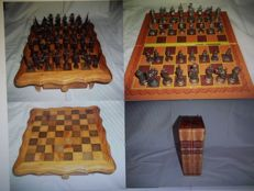 Two completely different chess sets with metal chess pieces