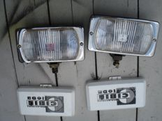 Two beautiful and used CIBIE IODE spotlights  with protective caps of the type 95 from the 70s and 80s with a width of 180 mm.