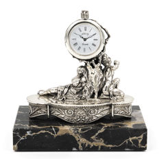 Alberty figure/clock in sterling silver with motif of Adam and Eve resting on a tree, finished on a marble pedestal