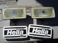 Two nice used HELLA COMET 550 FOG LAMPS with protective Hood from the 1980s and 90s with a width of 190 mm