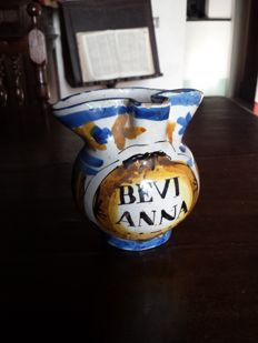 Antique painted majolica pitcher
