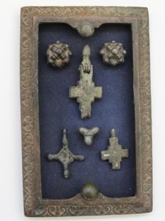 Three Early medival bronze crosses and three onlays in bronze frame - 12.4cm x 7.6cm