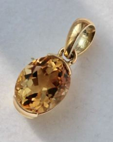 Yellow gold pendant, 14 kt, set with citrine - size: 6 x 19 mm.