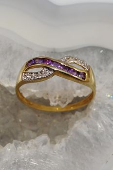 Gold cross-over ring with amethysts and diamonds