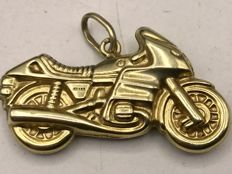 Handmade detailed gold necklace pendant in the shape of a motorcycle.