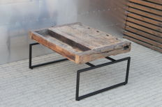 Kris Devillé - coffee/side table with a floating tabletop, made of an old workbench in oak wood