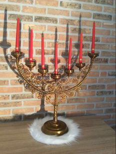Jewish 7-armed candelabra with candles in brass