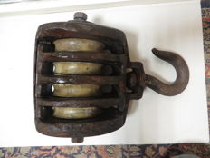 Heavy antique pulley.