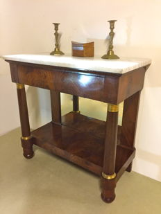 An Empire mahogany console table - with gilt bronze mounts- the Netherlands - first quarter of 19th century