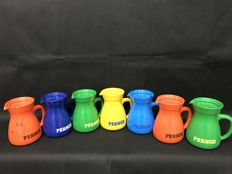 Many colourful Pernod pitchers