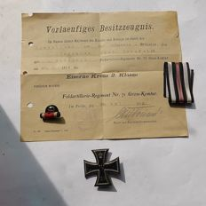 "WW1 German so-called ""Eisernes Kreuz class 1"", a buttonhole Pin, a E.K. Ribbon and a Bestizzeugnisch for E.K. 2nd class."