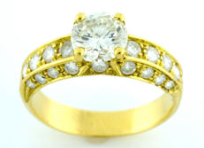 18 kt gold ring with brilliant cut diamond of 1.26 ct.  L-P1 (IGE certificate) and 26 brilliant of 0.9 ct approx.