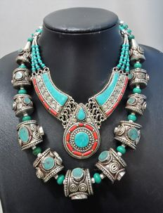 Two Tibetan style necklaces – Treated turquoise and coral paste – Marked 925.