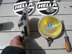 Two nice used HELLA  FOG LAMPS  type 160, with protective Hood from the 1970s and 80s with a width of 160 mm