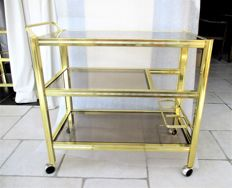 Brass (serving) trolley with matching table with shelves in black glass.