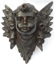Hand carved wooden Cherub's head lacquered in black - Italy - early 20th century