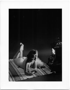 Unknown studio photographer - Artistic nude with dog in front of a blazing furnace