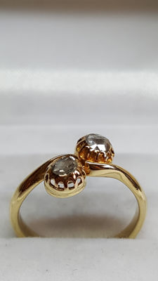 Yellow gold ring in 14 kt set with rose diamond