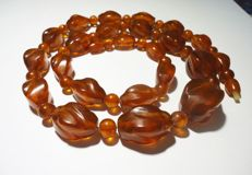 Vintage Russian Baltic Amber Necklace with cognac colour carved beads, 64 grams