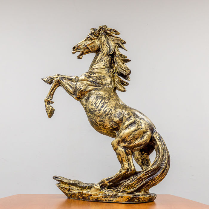 Bronze coloured prancing stallion.