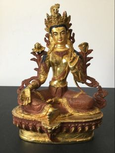 Representation of Green Tara in copper with gold decoration - Nepal - Beginning of 21st century.