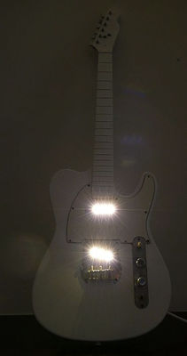 "Fabio Fiorentino, ""Music is my light"" electrical guitar transformed into a lamp"