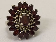 Silver entourage ring with marquise cut garnets and marcasites