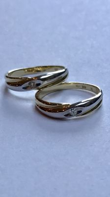 Set of 14 kt gold rings set with brilliant cut diamond. Ring size 18 (57) and 20 (63)