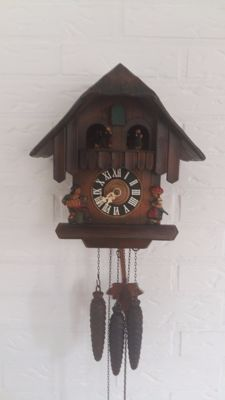 Black Forest Cuckoo clock type Chalet with play roller