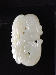 Pale green Jade pendant, floral carving, China, 20th century