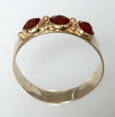 Gold women's ring with brown garnets.