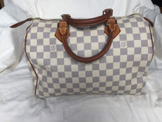 Louis Vuitton – Blue checkerboard Speedy 30 bag.